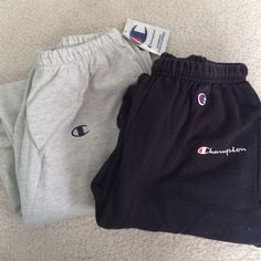 Two pairs champion sweatpants Gray pair NWT , black pair worn twice Champion Pants Track Pants & Joggers