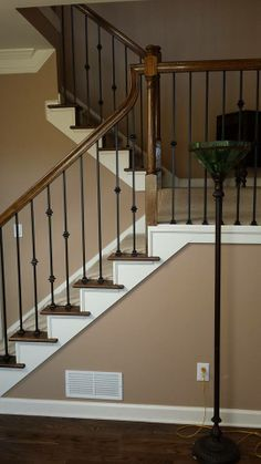 Whole House Resand With Stair Ends And Handrails To Match. Dark Walnut  Stain With Bona Satin Finish. And 101 Knuckle Series Iron Spindles.