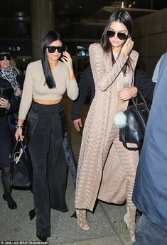 Kylie and Kendall Jenner show off their toned tums in matching beige crop tops as they touch down in LA after trip to Australia | Daily Mail Online