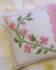 Floral cross stitch pincushion by GraceAndWhimsy on Etsy