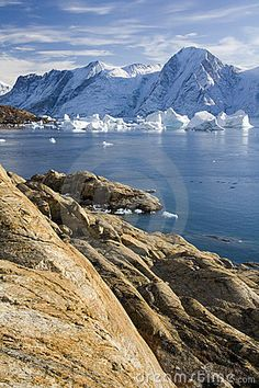 Northwest Fjord in the far reaches of Scoresbysund in eastern Greenland.  Note the pod of Narwhals just off shore.
