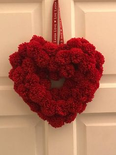 Heart shaped red pompom wreath Handmade red pompom heart with around 50 Pom-poms. Approximately 25 cm wide. Valentine Wreath, Valentine Day Crafts, Valentine Decorations, Pom Pom Decorations, Pom Pom Wreath, Tulle Poms, Tulle Tutu, Pom Pom Animals, Hand Made Gifts