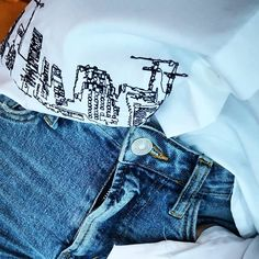 OSLO:UNBRANDED Oslo skyline embroidered on a white shirt paired with blue jeans Green Business, Oslo, Ethical Fashion, Sustainable Fashion, Blue Jeans, Denim Shorts, Pairs, Entrepreneurship, Skyline