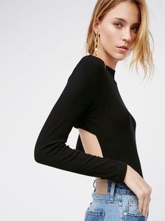 Element Tee | Stretchy ribbed long sleeve tee featuring a cute mock neck and an easy, rounded hem. Back cutout details add the perfect touch of cool.