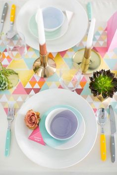 Go all out with a bright geometric table cloth + matching place settings.