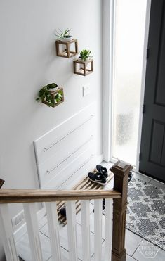 DIY Split Level Entry Makeover- I LOVE this entry. The oversize door, scandi influence and that shoe storage! Split Entry Remodel, Split Level Remodel, Hallway Shoe Storage Bench, Entryway Organization, Home Renovation, Home Remodeling, Split Level Entry, Entry Stairs, Basement Stairs