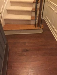 Armstrong Frontier Hickory on floor, oak stairs