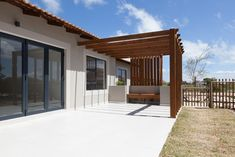 Clean and simple design open plan layout with functional spaces,natural wood textures add warmth. Designer home in Langebaan Country Estate. Country Estate, Pergola Patio, Wood Texture, Open Plan, Simple Designs, Natural Wood, Architecture Design, Layout, Outdoor Structures