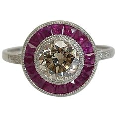 Art Deco 1.69 Carat Ruby Diamond Platinum Target Ring   From a unique collection…