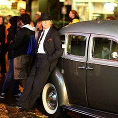 LEAN BACK  Pierce Brosnan looks just dandy, thank you, next to a vintage Rolls-Royce on the Vancouver set of his 1940s period drama Marriage on Tuesday | Pathos