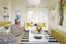 Black and white rug target living room beach style with mixed patterns mixed patterns open shelves Eclectic Living Room, Living Room Sofa, Contemporary Beach House, Casual Living Room Decor, Trendy Living Rooms, Retro Style Living Room, Coastal Living Rooms, Living Room Area Rugs, Rugs In Living Room