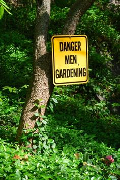 """A humorous garden sign: """"Danger: Men Gardening"""" was one of the first views I noticed near the driveway."""