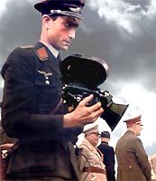 Walter Frentz,a Luftwaffe Cameraman who became Hitler's personal cameraman. In 1941, he was at Hitler's Wolf's Lair bunker in East Prussia, staying with the inner circle until shortly before the end of the war. He witnessed a massacre of civilians in the present-day Belarus during a trip with the SS chief Heinrich Himmler and was sworn to silence on his return. In March 1945 he took the last pictures of Hitler in his Berlin bunker. Fleeing Berlin on one of the last planes out.  He died in…