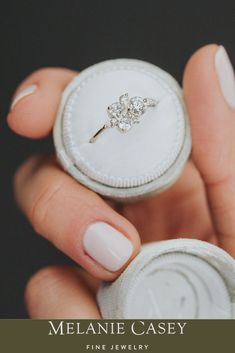 One of our most unconventionally beautiful engagement rings. The Stars at Eventide Ring sparkles with an asymmetric arrangement of pear, oval, and round cut white diamonds, set into a band of solid 14k white, yellow, or rose gold. Inspired by the unforgettable splendour of a clear night sky, this ring is a beautiful reminder of your unique love story! Find more photos of this made-to-order piece on melaniecasey.com. Necklace Chain Lengths, Necklace Sizes, Bracelet Sizes, Velvet Ring Box, Round Diamonds, White Diamonds, Beautiful Engagement Rings, Pretty Rings, Or Rose
