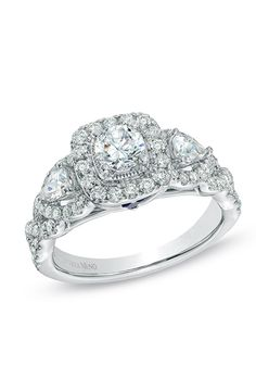 Brides.com: . Style 19962357, diamond three-stone engagement ring in white gold, $4,499.99, Vera Wang LOVE available at Zales
