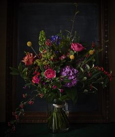 Scarlet & Violet, London. A bright arrangement in a small pickle jar