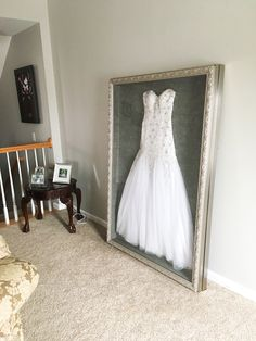 Instead of putting my wedding dress in a box hidden in the attic or possibly selling it, I had it shadow boxed to display it.  Made at Hobby lobby. 40x60. $700. #weddingdress