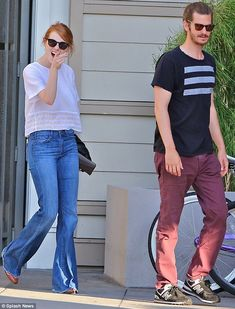 Casual cool: The 26-year-old actress looked good in a white top over blue flared jeans and...