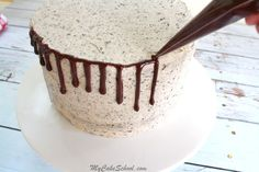 Adding an easy and delicious ganache drip to our scratch Oreo Cake. My Cake School.