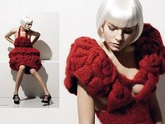 "Structured 3D Red Knitted Dress - constructed fashion.  Constructed fashion is designerese for ""Weighing forty pounds and so stiff and heavy that it will not bend enough to sit down properly and you walk like you're on a ship at sea during a hurricane!"""