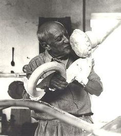 Lee Miller's photograph of Pablo Picasso embracing a sculpture of a baby.