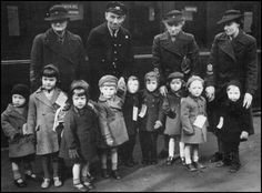 Children at train station being evacuated to he country ....