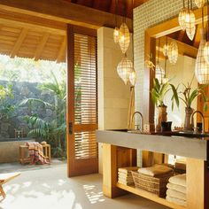 Asian inspired indoor/outdoor bathroom design with lantern pendant lights, and a stone bathtub outside. Indoor Outdoor Bathroom, Outdoor Tub, Outdoor Baths, Outdoor Stone, Outdoor Showers, Rustic Outdoor, Asian Bathroom, Tropical Bathroom, Master Bathroom