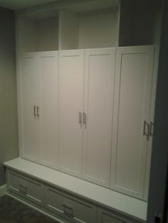 Mud Room Lockers with Drawers and hooks behind a Door.  Open Space above