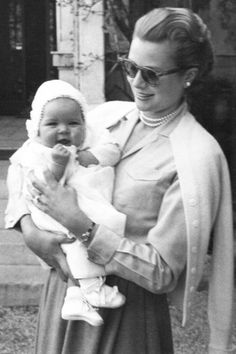Princess Grace posing with her first daughter Caroline. Monaco, June 26, 1957.