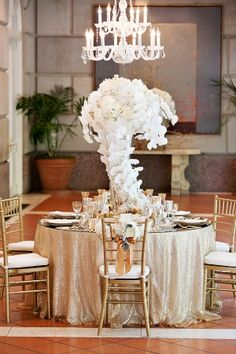 Elegant orchid centerpiece | photography by www.perezweddings.com/