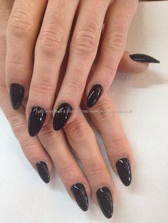 Almond shape acrylic nails with black gel polish