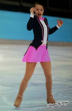 Custom made black/pink Ice Skating Costume designed and created by Sonja Ballin. All Designs copyright ©2014, Sonja Ballin of Tampa Bay, Florida. www.sonjadesigns.com Check us out  (and like) on Facebook:  https://www.facebook.com/pages/Designs-By-Sonja/220737151285770