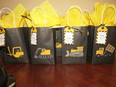 Construction party loot bags for the adults - cleaning up from the construction site with all natural bars of soap, Starbucks coffee gift cards and truck cookies for break time.