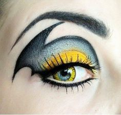 Eye Makeup Batgirl.  Batgirl, Bat girl, female version of the classic Batman, has a dramatic eye makeup! You know who you will be on your next costume party ...