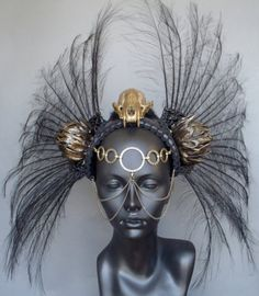 Skull and feather headdress with ornamental face chains