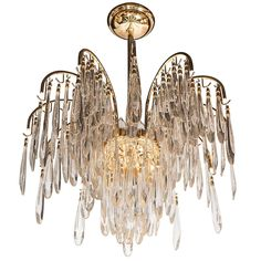 Stunning Mid-Century Modernist Twelve-Arm Chandelier in the Manner of Lobmeyr | From a unique collection of antique and modern chandeliers and pendants at https://www.1stdibs.com/furniture/lighting/chandeliers-pendant-lights/