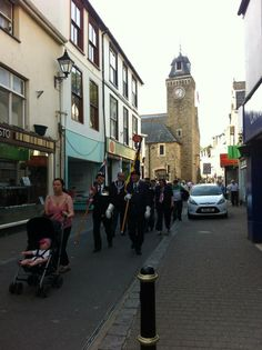 Parading through Looe on the way to the Banjo Pier