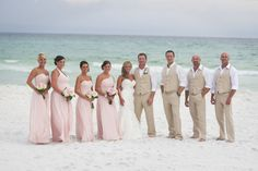 Blush Beach Wedding Party but grey for the guys and navy for the girls...coral accents   The guy outfits that's it