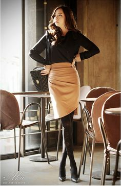 Love the black with soft peach. Drape of skirt is both elegant and appropriate.