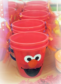 Red bucket painted to look like Elmo for party favor or goodie bag