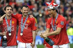 Neville, Ryan Giggs (centre) and Ronaldo (right) celebrate winning the Premier League in M...