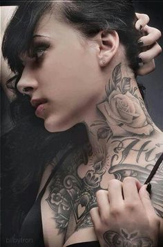 Neck rose tattoo is awesome