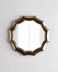 Sinclair Scallop Mirror at Horchow.  Ideal for above bed.  three hundred.