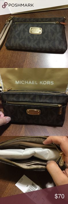 Michael Kors wristlet Brand new never used... can be used as a wristlet or a mini pocketbook MICHAEL Michael Kors Bags Clutches & Wristlets