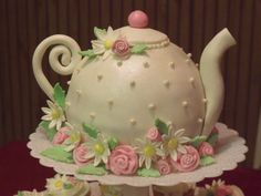 Teapot Cake - In honor of my aunt's 85th birthday, her daughter threw her a suprise tea party, complete with little finger sandwiches, scones, beautiful china and even live piano music.  I've always wanted to try to make a teapot cake and since we were having a tea party....  The cake was a big hit!