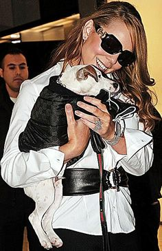 Mariah Cary and her dog Jack.  She has four Jack Russell Terriers.