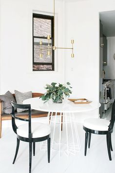 We rounded up chic dining room light fixtures as well as examples of how to decorate with them. Find out how to illuminate your dinner spread in style.