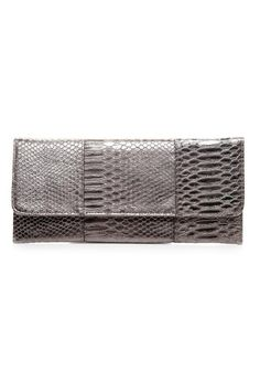 Designed with faux leather and snake skin detailing to help with scratch resistance. Feastures a sliver chain and interior zip pocket.  Dimensions: 11 3/4 L x 5 1/4 W  Envelope Clutch by NAMES Accessories. Bags - Clutches Canada