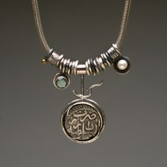 Wendy Thurlow: 'Artifact Cluster'. Ancient coin from India. Sterling silver, 18k gold, pearl, labradorite. Hangs on snack chain including a handcrafted clasp.