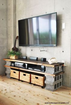 DIY cinder block TV cabinet. Put wheels under basket as drawers for DVD's etc. No nails or hammers necessary. All this for under $60! Design by Maiko Nagao.: